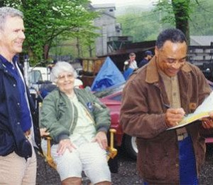 On Set: Mr. Bolden (Randy Stripling) signs a script for Homer and Elsie.