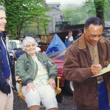 On Set: Mr. Bolden (Randy Stripling) signs a script for Homer and Elsie.